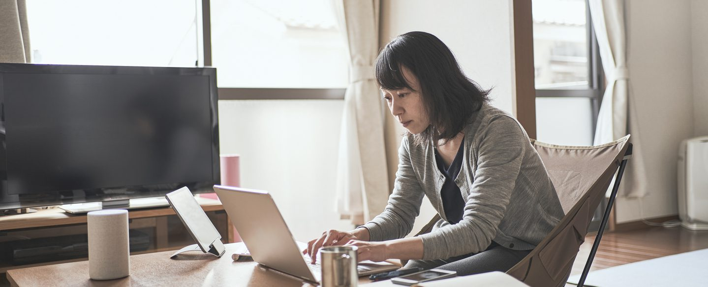 woman working remotely on a laptop