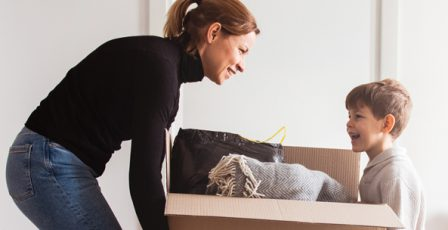 Woman and child moving house