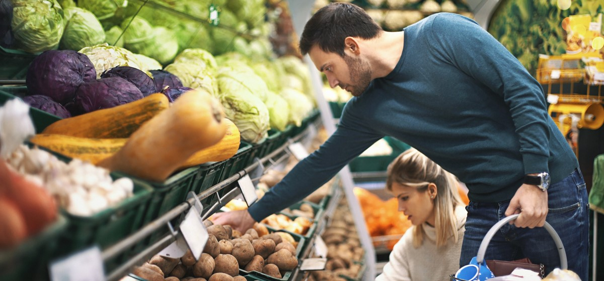 Man buying fruit and vegetables in a supermarket