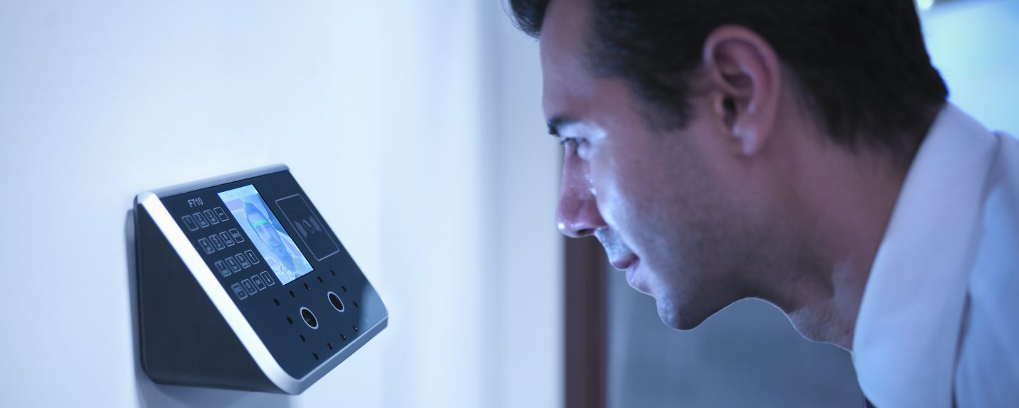 Businessman using face recognition system for office security