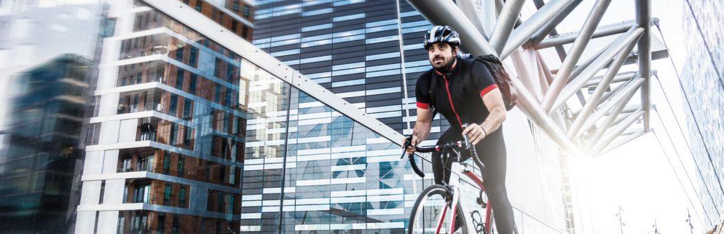 Cyclist riding along a bridge